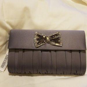 Handbags - NWT silver evening bag.